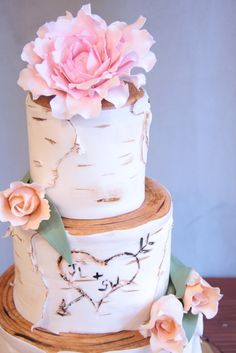 Spring brides take note: A beautiful birch tree wedding cake with peonies and tulips!