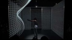 "Hakanaï is the union of two Japanese characters—one meaning ""man"" and the other ""dream""—used to define the ephemeral and the fragile. In this dreamlike environment, a single dancer moves within a cube, interacting with the images projected on its walls, tracing arcing parabolas and sine waves with hands, arms, and feet. By Adrien M and Claire B"