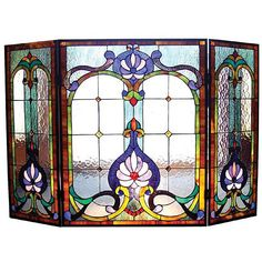 This elegant fireplace screen is a classic Victorian design. A welcome addition to any home decor, the screen is created from pieces of stained art glass and features cheerful shades of blue, green, gold, beige and clear water glass.