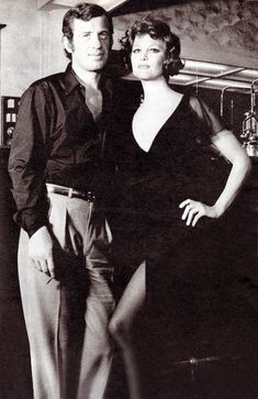 I Love Jolie I think she is hot but there is a way to show your leg. Claudia Cardinale and Jean-Paul Belmondo