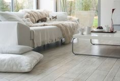 Vinyls Flooring.. Loving the washed out white look wood..