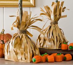 Broom Bags Cut the sides of a paper lunch bag into strips, leaving the bottom of the bag in tact. Put cotton fill (if you are displaying) or candy inside, put the stick in the middle, and tie the strips around the stick with jute string. Variation: paint the bag black first to make a witch's broom!