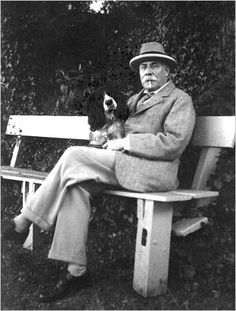 Edward Elgar smoking a cigarette with his dog Marco.