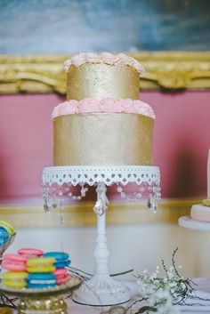 Gold buttercream wedding cake and colourful macarons