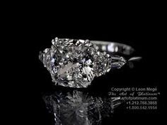 Cushion cut with pear sides. SO PRETTY!