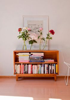 low shelf + books + flowers