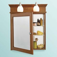 Strasser Woodenworks medicine cabinets with built-in lighting for tight bathroom space.