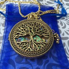 A personal favorite from my Etsy shop https://www.etsy.com/listing/246171046/tree-of-life-pendant-necklace-magnifying
