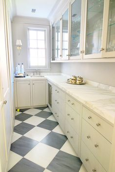 Diagonal checkerboard marble. Gorgeous. Love that it's grey rather than black - much softer look. Suggestions are to use marmoleum to get a similar look with less hassle and softer on the back. Or possibly cork.