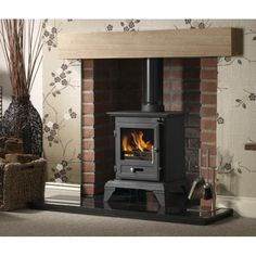 The Gallery Classic 5 Cleanburn wood burning multi fuel Stove is one of the newest additions to the Gallery range of stoves. The Classic 5 is a wood burning and multifuel stove that is Defra approved so can be used in smoke controlled areas. Wood Burner Fireplace, Cast Iron Fireplace, Fireplace Ideas, Electric Fireplace, Small Stove, Multi Fuel Stove, Freestanding Fireplace, Victorian Fireplace, Electric Fires