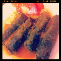 Dolmedes: hot stuffed vine leaves with rice and minced pork served with tomato sauce