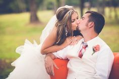 #coral #brightchair #kissing #wedding #funwedding #summerwedding #brightwedding #pinkwedding #pinkandcoral #blonde #georgia #southernwedding #lakewedding