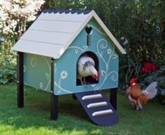What a cute little coop with the lovely drawn flowers on the sides of the coop and a white roof. The chickens must be very happy living there. Look at this coop here: