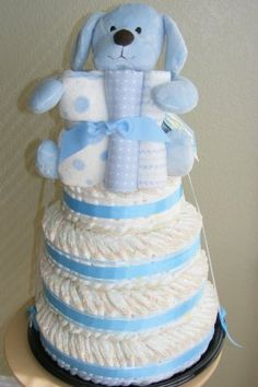 Diaper cake ideas ****Uses a paper towel roll in center to attach diapers to***** Great Idea