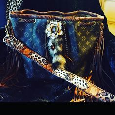 Authentic Louis Vuitton Louis,leopard,fringe,coontail and rustic flower and beads! What a combo! Can't call this LV boring! Like our facebook page Silver horse Ranch Designs and Silver Horse Ranch for chance to win a fringed Louis Vuitton for Valentines! Louis Vuitton Bags Hobos