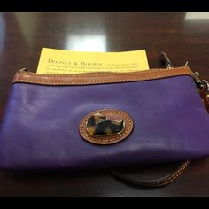 Authentic Dooney & Bourke Wristlet-New! Perfect stocking stuffer for the avid D&B fan! The purple leather is very soft and will brighten any outfit! Great for going out with friends because it holds just enough! Comes with the D&B registration card. Dooney & Bourke Bags Clutches & Wristlets