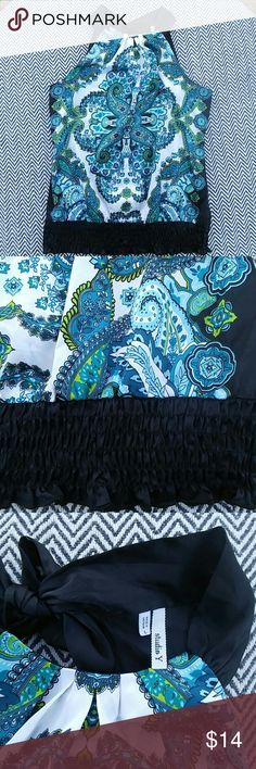 Blue and green Paisley blouse with back neck tie Blue and green Paisley blouse with back neck tie. Size L. Great condition, worn twice. 100% polyester. Such a fun top!! Tops Blouses