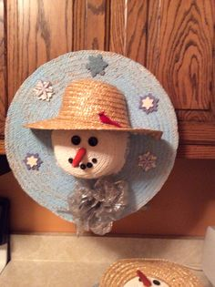 Snowman wreath made from 2 straw hats. Very easy to make