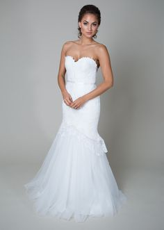 {Charlotte Fleur} Vivid and flirtatious, this exaggerated mermaid wedding dress features a sweetheart neckline, petal hem with a flowing tulle skirt, a structured illusion back with a functional zipper and covered buttons. Soft and sweet, this would be amazing for a garden wedding!