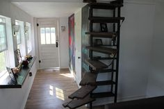 Kaitlin+Snyder's+custom+spiral+staircase+and+bookshelf+is+finished,+as+seen+on+Tiny+House,+Big+Living.