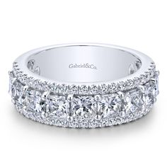 Voted #1 most preferred fine jewelry brand. 14k White Gold Princess Cut Fancy Diamond Anniversary.Three rows of French pave and prong set diamonds adorn this luxurious, glittering anniversary band