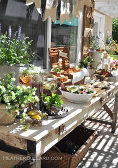 Food display: baskets, footed bowls, vintage platters, tart tins as an assortment of serving pieces