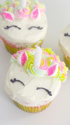 Recipe with video instructions: What's more adorable than unicorn cupcakes? Slicing into them to discover rainbows! Ingredients: Cake Batter:, 2 cups all-purpose flour, 1 tsp salt, 3 ½ tsp baking powder, ½ cup unsalted butter, room temperature, 1 cup sugar, 1 tsp vanilla extract, 2 eggs, 1 cup milk, pink, orange, yellow, green, blue and purple food colouring, Buttercream:, 2 cups unsalted butter, room temperature, 1 tsp vanilla extract, 5 cups confectioner's sugar, pink, yellow, green, bl...