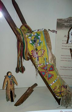 American Indian cradle board, Indian doll, and dagger.