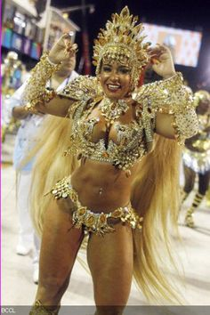 Samba dancers in glittering costumes and bedecked with feathers