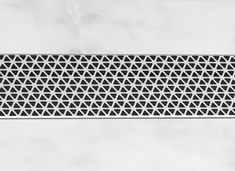 Australian designer Marc Newson had turned his attention to the humble shower drain -close up