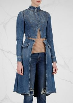Alexander McQueen blue denim coat High neck, lightly padded shoulders, button-fastening cuffs,front flap pockets, split front with cut-out waist, pleated flared skirt, decorative top stitching, partially lined Concealed hook fastenings through front 100% cotton; lining: 50% cotton, 50% viscose