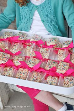 all things simple: a simple treat: rice krispie pops - Cute party favor for Emmie's rainbow party