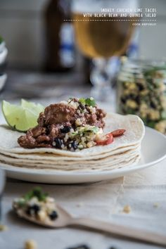 Smokey chicken lime tacos with black bean and quinoa salad.