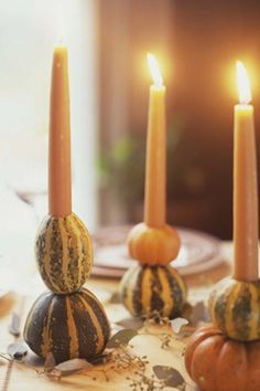 Hollow out the middle of a couple miniature gourds and pumpkins, then slide in a taper candle for a seasonal DIY candlestick.
