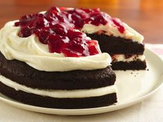 The delicious layers of chocolate, creamy frosting and bright red cherries create a festive gluten-free dessert.