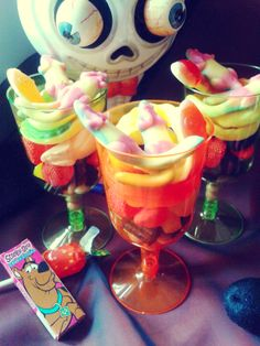 Halloween Party cups by SweetnGroovyStuff filled with yummy sweets #halloween #trickortreat #sweets #kids #sweetcones #jelly #snakes #party #candy #sweetcart #manchester #candybuffet #lollipops #skull #orange #green #sweetngroovystuff www/facebook.com/sweetngroovystuff
