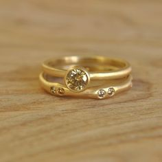 This ring is just gorgeous. yellow gold and champagne diamonds. Handmade on Etsy by Silverwoods. $965