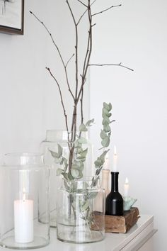 candles, eucalyptus and branches a perfectly styled sideboard glass jars and candles minimal scandinavian decor Bathroom Candles, Bathroom Counter Decor, Bathroom Countertops, Bathroom Interior, Kitchen Decor, Interior Livingroom, Apartment Interior, Bathroom Ideas, Scandinavian Interior Design