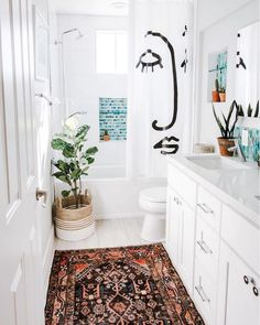 Switch out your old shower curtain for something with a little more character. Want to find out other ways to makeover your bathroom? Check out 13 Easy Ways to Freshen Up Your Bathroom. #vanity #hardware #bathroom #interiors #tips #makeover #affordable #bathroomupgrade #showercurtain #targethome