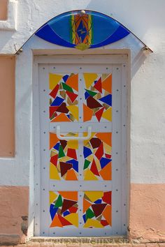 "Painted door, Vitebsk, Belarus -- with talisman to ward off the ""evil eye"" above the door 