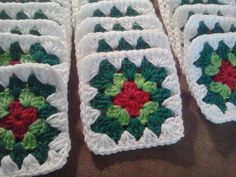 These Christmas Granny Squares are inspiring me to crochet something Christmassy one of these years! The pic an old Etsy listing by stephsyaya.