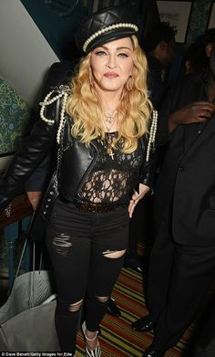 The pearly queen: Madonna looked typically eye catching in her matching leather cap and jacket as she celebrated
