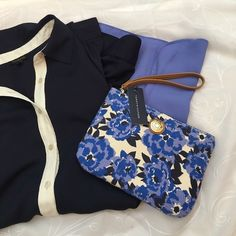 NWT TOMMY HILFIGER WRISTLET Brand new large wristlet from Tommy Hilfiger. Beautiful navy blue floral on a fabric background. Would fit an iPhone 6s Plus or small and room for lots more! Comes from a smoke free and pet free home. Open to all offers! Tommy Hilfiger Bags Clutches & Wristlets
