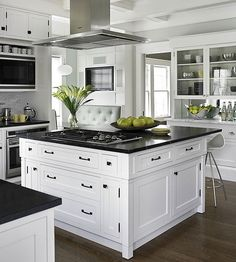 I like this kitchen...both classic and modern. I especially like the dining area (booth style) with a TV and large window.