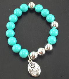 Stunning Aqua acrylic beads with Silver toned beads and charm on stretch bracelet