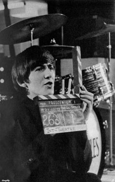 """George on set at the Scala Theatre during the filming of A Hard Day's Night, 1964.  Scanned from """"The Beatles Film"""" souvenir magazine (1964)."""