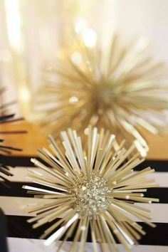 Styrofoam balls & toothpicks & gold spray paint. About 20 years ago, we had a receptionist who made styrofoam balls covered in sequins and ribbon. Thanks for the idea Cynde!
