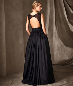 CONCESA. Aristocratic, long princess-style dress. A dress with a bateau neckline, sleeveless with a wide skirt that is a perfect blend of taffeta, tulle and gemstone embroidery in small details. A work of art for a magnificent celebration.CONCESA, Wedding Dress 2017