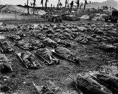 W. Eugene Smith WORLD WAR II. The Pacific Campaign. June 1944. Battle of Saipan Island. US soldiers killed during the battle.