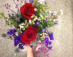 Red roses with wild flower bouquet.